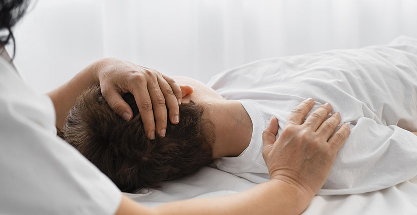 female-osteopathist-treating-boy-by-massaging-him