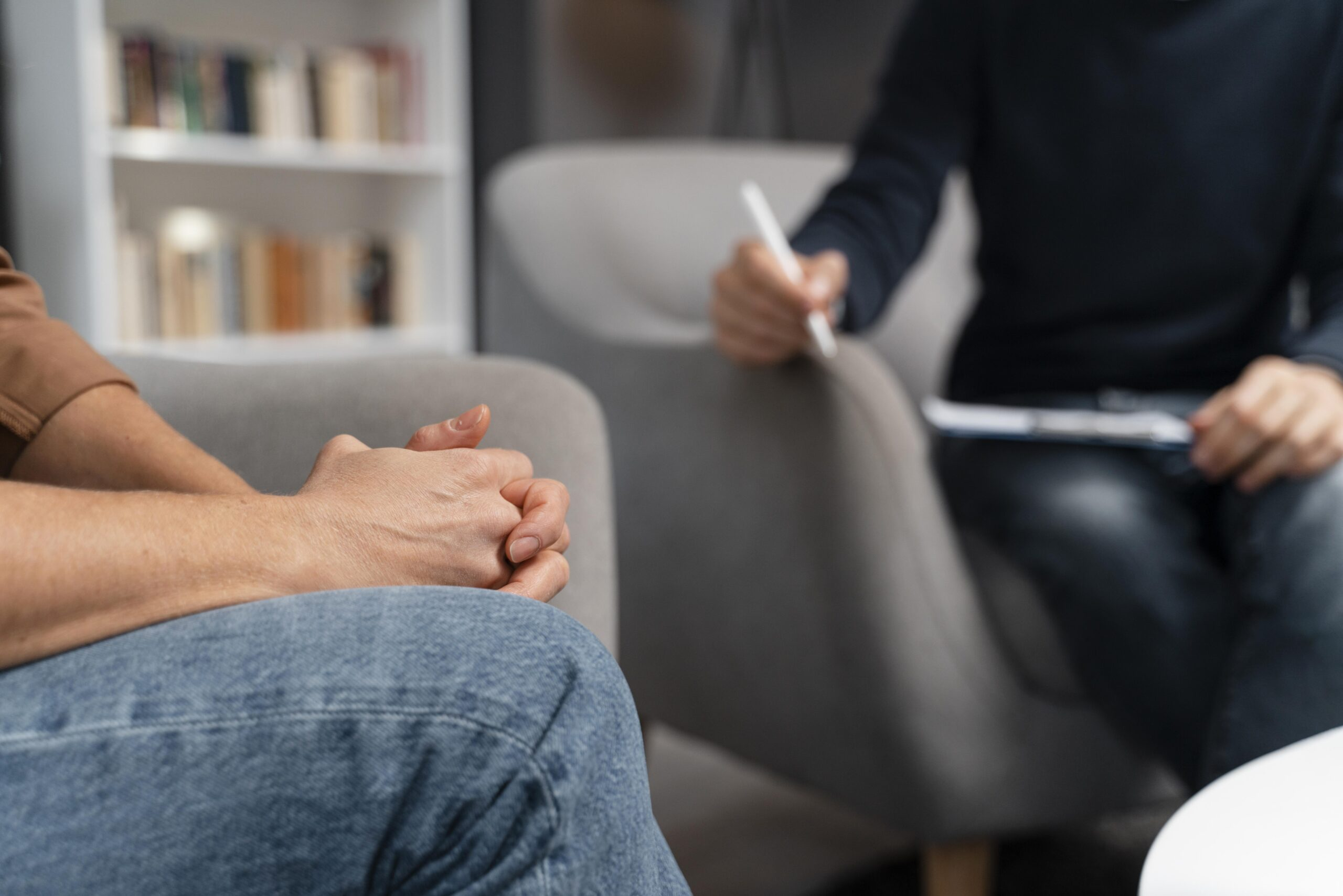 woman-with-hands-together-talking-with-counselor